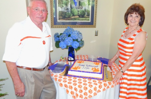 Mac and Elaine Horton prepare to cut his retirement cake.