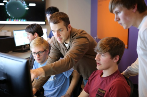 John Hoyt works with students Zach Whitworth, Grant Adams and Carson Sallis in Clemson's new Cybersecurity Operations Center.