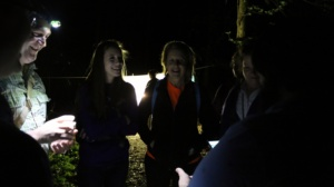 "Clemson entomologist Michael Caterino (left) discusses nocturnal insects with several attendees of ""Light Up the Night!"""