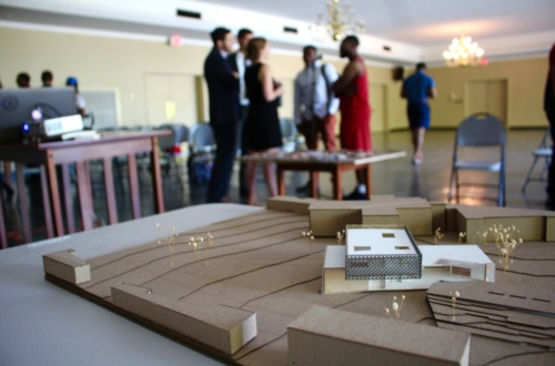 Clemson and S.C. State students chat after a meeting on the Orangeburg campus to talk about architectural ideas for a new student center. A 3-D model is seen in the foreground.