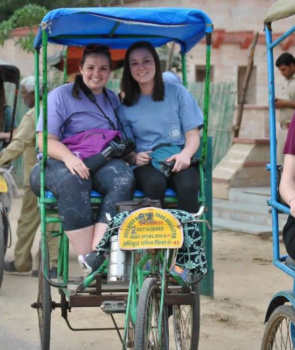 Clemson students Kara Robertson, right, get ready for a tour in India on a ricksha.