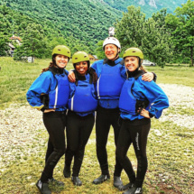 Three Clemson students, including Emily Clarke, and a professor outfitted in white water rafting gear.