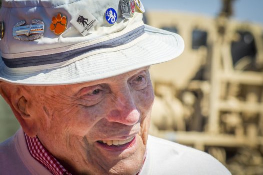 Retired U.S. Army Col. Ben Skardon, 98, a survivor of the Bataan Death March, shares a laugh with a group of supporters after walking more than eight miles in the 27th annual Bataan Memorial Death March at White Sands Missile Range, N.M., March 20, 2016. Skardon is the only survivor who walks in the memorial march and this year marked his ninth in a row. (U.S. Army photo by Staff Sgt. Ken Scar)