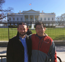 Fifth-year doctoral student Yan Liu (right) stands in front of the White House in Washington with his advisor, Christopher McMahan.