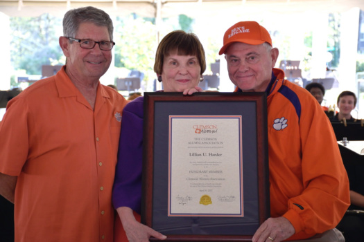 Mickey Harder (center) accepts the honorary alumna award from Danny Gregg (left) and Col. Sandy Edge.