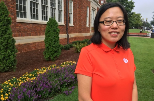 Lu Yu stands outside Riggs Hall, where she does research with Richard Brooks.