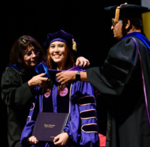 Ph.D. recipients were honored Thursday at the Doctoral Hooding Ceremony.
