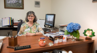Roberta Elrod sits at her desk on Clemson's campus.