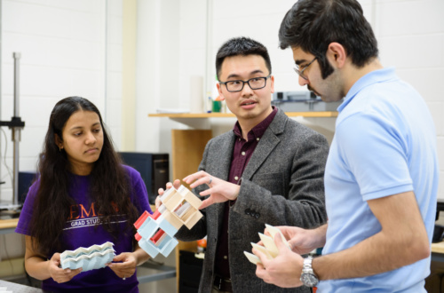 Suyi Li, center, works in his Clemson University lab with Ph.D. students Priyanka Bhovad, right, and Sahand Sadeghi.