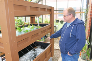 Lance Beecher with aquaponics system