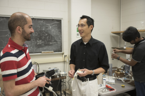 Ethan Kung works in his Clemson University lab with two of his Ph.D. students, Masoud Farahmand (left) and M. Sabbir Salek (right).