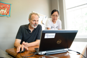 Richard Brooks, left, works with postdoctoral researcher Lu Yu in his Riggs Hall office.