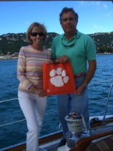 Asa and Marilyn Godbold pose on a boat holding a Tiger Rag.