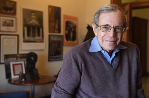 Image of Eric Foner in office in front of historic images