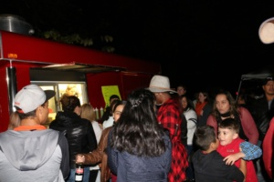 Participants in Clemson's first-ever Day of the Dead celebration line up at this food truck for Mexican foods such as tamales.