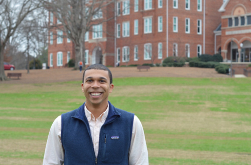 Chris Norman, standing in front of Tillman, is a first-generation graduate