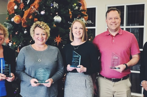 Staff award winners were (from left) Teresa McAllister, Leigh Humphries, Kaley Goodwin, and James Lowe. They posed for a photo with Anand Gramopadhye, dean of the College of Engineering, Computing and Applied Sciences.