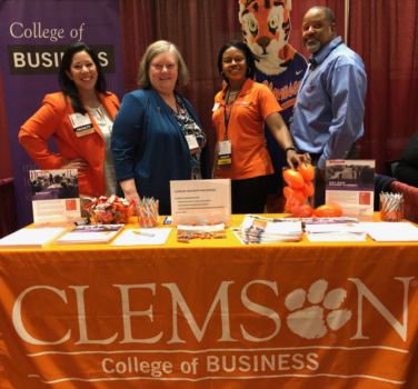 Staff, faculty staff the Clemson booth at PhD Project conference