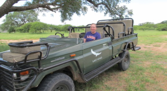 Laura Gigliotti sits in a safari truck in South Africa.