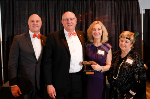 Jay and Julie Seitz receive an award as generous donors at the 2019 Student Affairs Gala from President Jim Clements (left) and Almeda Jacks (right).