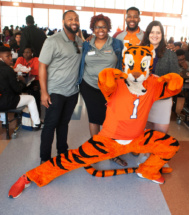 The Tiger posing with (L-R) Jason Combs, Emerging Scholars associate director; Laetitia Adelson, graduate assistant; Matthew Kirk, Tiger Alliance associate director; Amber Lange, College Outreach and Preparation director.