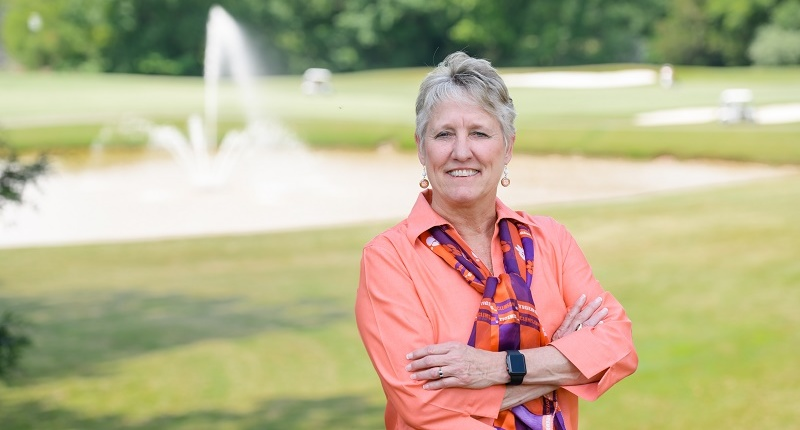 Melinda Chappell stands outside Madren Center, overlooking the Walker Golf Course